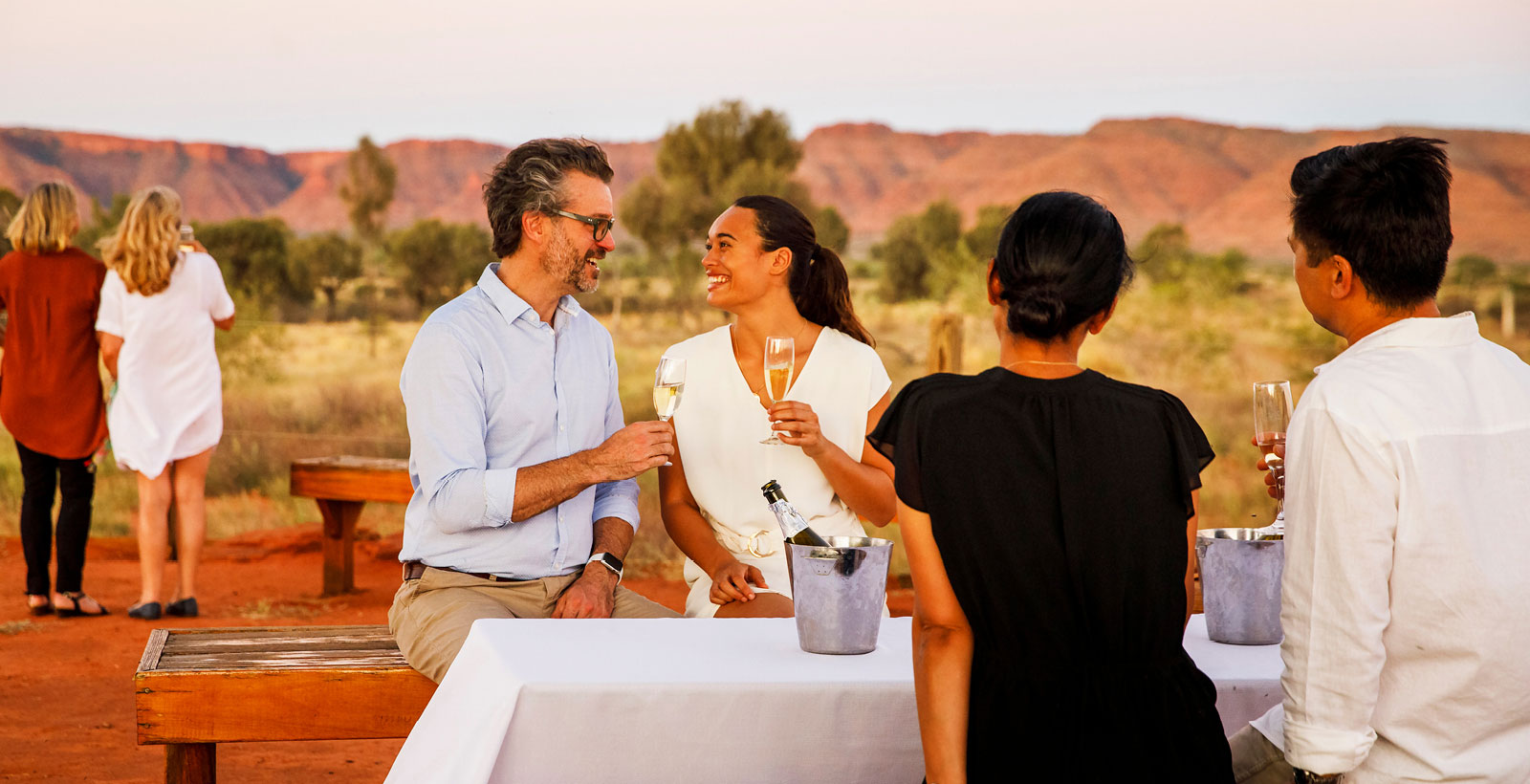 red centre couple reconnect with champagne